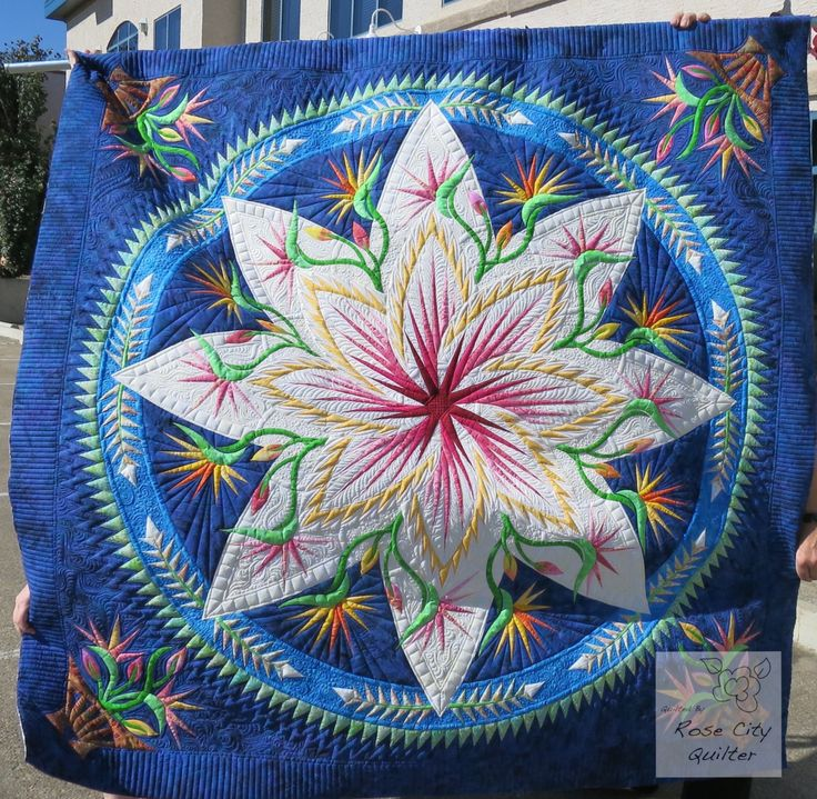 It is no secret: I love texture!!! In fact I am almost obsessed with it! So when I quilted this Paradise In Blooms quilt by Anne Hall, texture was my main focus. Anne wondered if coloured thread sh…