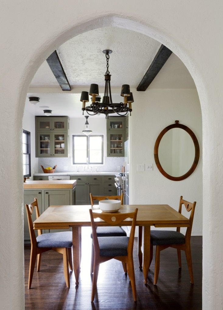 Glenn Lawson Spanish Colonial by DISC Interiors | Remodelista -- I like how the oval mirror give weight and balances the left view of the kitchen.