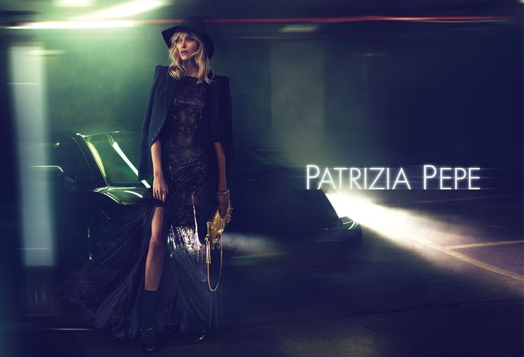 In the background of the Parking Garage, the clean, minimalist lines of a luxury car represent a concrete element in the subtle setting in which the Patrizia Pepe woman poses