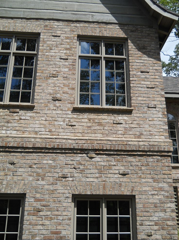 "A new brick home can have an ""Old World"" feel with clinker accent bricks. Other details like a corbelled accent band with special shape brick and rowlock course, special shape brick sill and jack arch showcase the versatility of brick. http://insistonbrick.com/"