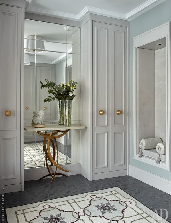 Vestibule - wardrobe one side, mirror and console table the other , no gold