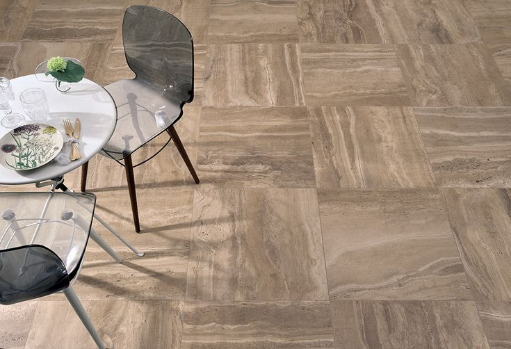 "REVERSO #stone-effect #porcelain #stoneware interprets the back side of #travertine slabs, with slight #imperfections, less evident and almost faded surface graphics. The #style is in line with the ""raw"" trend: the #charm of irregular #surfaces, interpreted with #elegance and #sophistication."