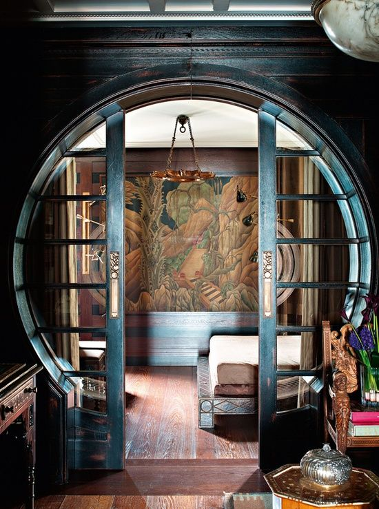 Round door opening with glass pocket doors. Could you ask for more?