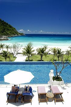 Pool and beach view at The Racha Hotel Phuket, Thailand