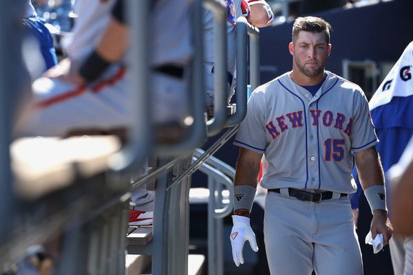 Tim Tebow #15 (New York Mets) of the Scottsdale Scorpions watches from the dugout during the Arizona Fall League game against the Peoria Javelinas at Peoria Stadium on October 13, 2016 in Peoria, Arizona.
