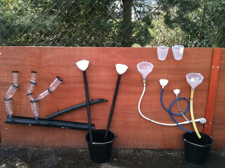 Make your own water wall with pipes, tubing, bottles, funnels, jugs and buckets