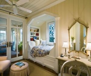 Cozy bed in a windowed nook by tiffany