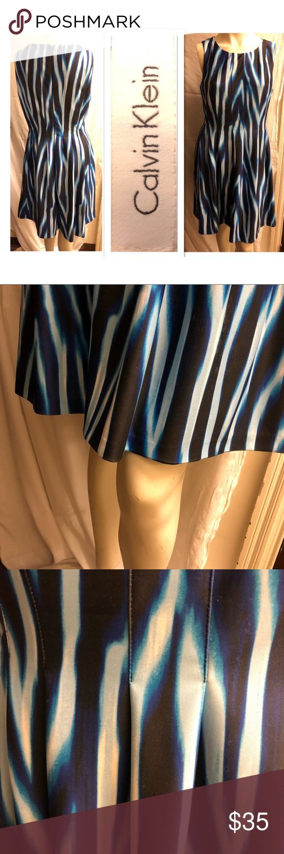 """Calvin Klein Scuba Stretch Tie Dye Stripe Dress This dress feels like heavy, stretch yoga pants. It's also fully lined, and the lining is stretch as well. It's tapered in at the waist and pleated to allow for a fuller skirt. Very comfortable!  I would say turquoise, sky blue, royal blue, black and white. Hidden black nylon zipper 20 inches with hook and eye at top Flat measurements: Armpit to armpit 20"""" Shoulder to shoulder 14"""" Shoulder seem to bottom of the dress 39"""" Calvin Klein Dresses"""