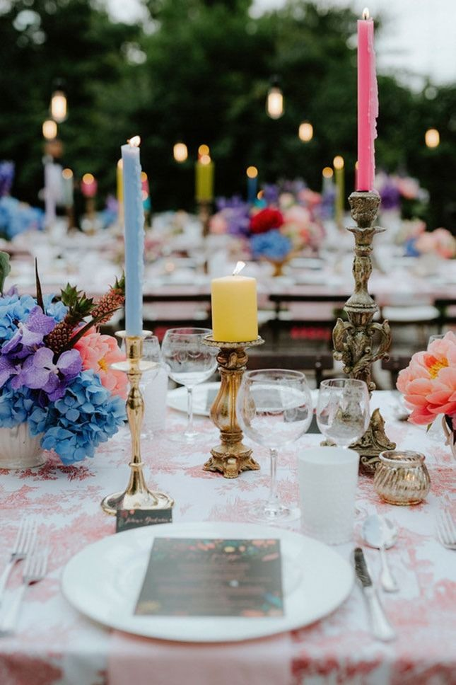 Bring in some thrifted, antique-looking candleholders for that oh-so-eclectic vibe on your wedding day.