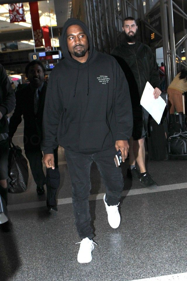 Kanye West wearing Fan Merchandise Kanye West Hollywood Bowl Hoodie, Adidas Ultra Boost Shoes, Acne Ace Used Cash Jeans