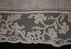 """Mechlin lace... is one of the best known Flemish laces. It is fine, transparent, and looks best when worn over another color... It was used for coiffures de nuit, garnitures de corset, ruffles and cravats.""    # A study in nostalgia."