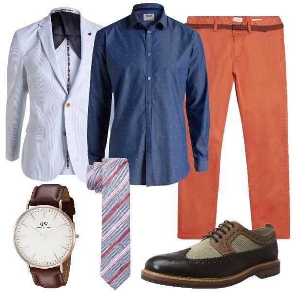 Un papà che ama lo stile curato e le cose belle apprezzerà l'eleganza di un orologio Daniel Wellington. Una combinazione cool composta da pantalone arancio, blazer light blue, camicia e cravatta in fantasie a contrasto e scarpa derby in marrone.