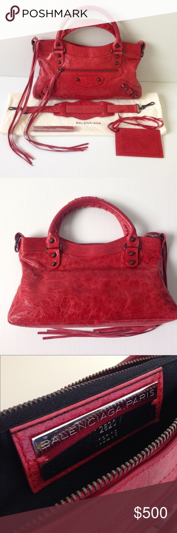 """Balenciaga Classic First bag Gorgeous Balenciaga First Bag in distressed bright red leather with incredible classic stud and tassel details comes with a matching mirror, spare tassels, a detachable shoulder strap and a dust bag. Dimension: 7 1/2""""H x 13""""W x 2 1/2""""D. Made in Italy. The exterior leather is clean. Light wear on handles. Minor scuff at bottom corners. Wax edges start to wear off in some areas. The interior lining is clean and in good condition. Hardware shows some light…"""