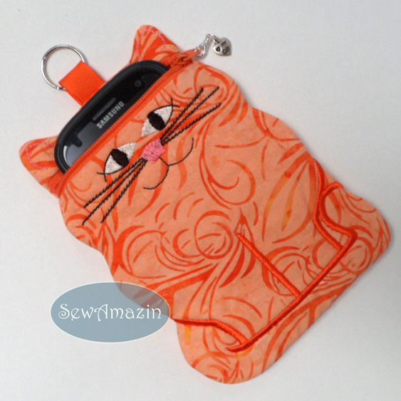 Orange Marmalade Kitty Cat Zipper Pouch, Cell Phone Case, Tech Case: Carries your digital camera, iPhone, Android or other small tech device with room to spare! Purr-fect gift idea for cat lovers! Made of orange batik cotton quilting weight fabric and lined with fabric that reminds me of an orange creamsicle.  Lightly padded and fully lined with no raw edges showing. #bmecountdown