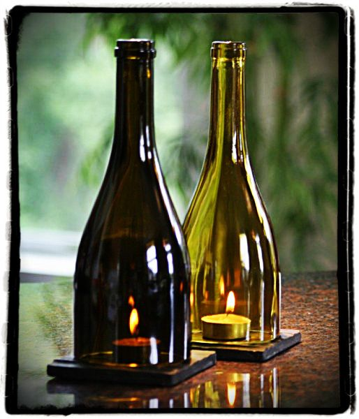 Wine Bottle Candle Holder- something like this on the planners chargers  or wood slices?!?!,