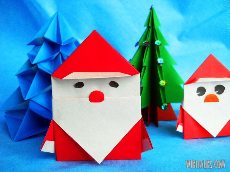 Santa Claus made out of paper, this is a simple and original model. Red coat with sleeves, hat with white lapels and huge beard - all made from a single sheet of paper. This flat figure may be placed in a card or envelope together with your Christmas greetings. Embossed details create a sense of depth, and if you place it on Christmas tree it will also look great.   Square sheet of colored ...