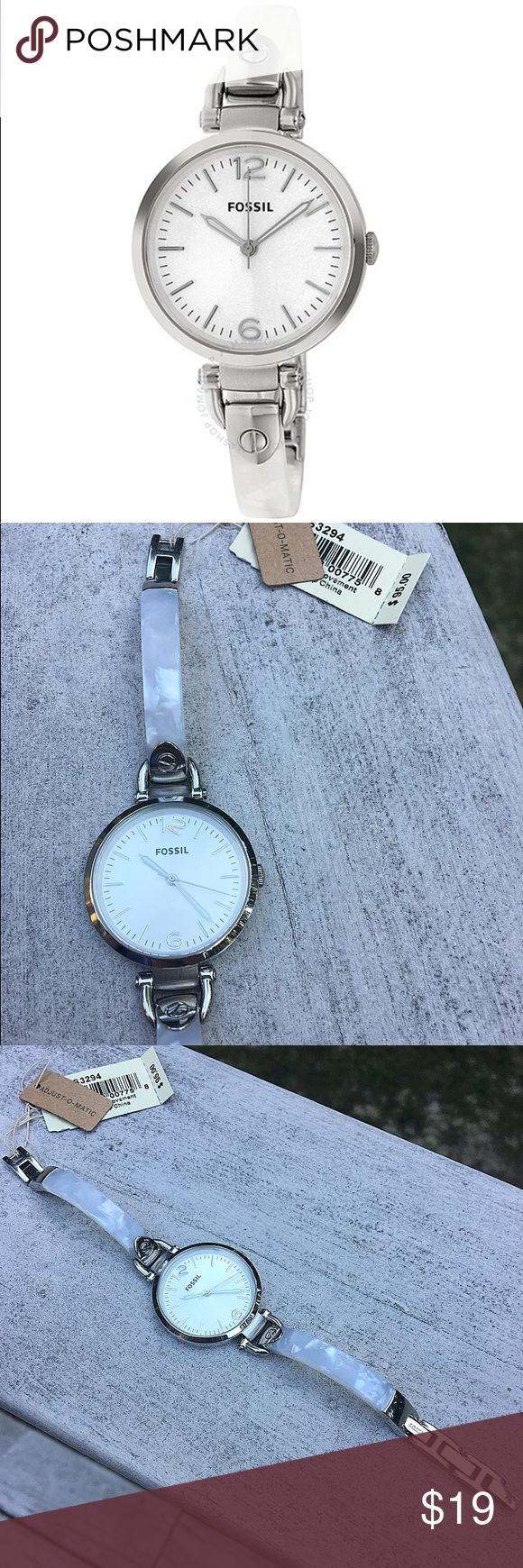 """Women's White Fossil Watch NWD Women's white acrylic and silver steel Fossil watch with removable chain link band. Watch has never been warn and is in excellent condition! Tags still attached! One of the """"12"""" markers are loose and floating in face. This can be repaired by Fossil if sent to company. Needs new battery! Authentic. No trades! Fossil Accessories Watches"""