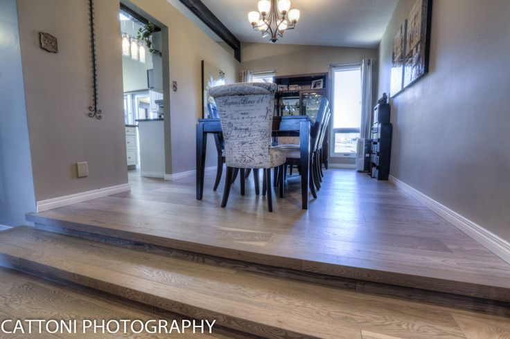 The dining room of this beautiful Home features Lauzon Flooring Fifth Avenue Wire Brushed hardwood flooring from the Urban Loft Series. #interiordesign #hardwoodfloor #artfromnature #diningroom