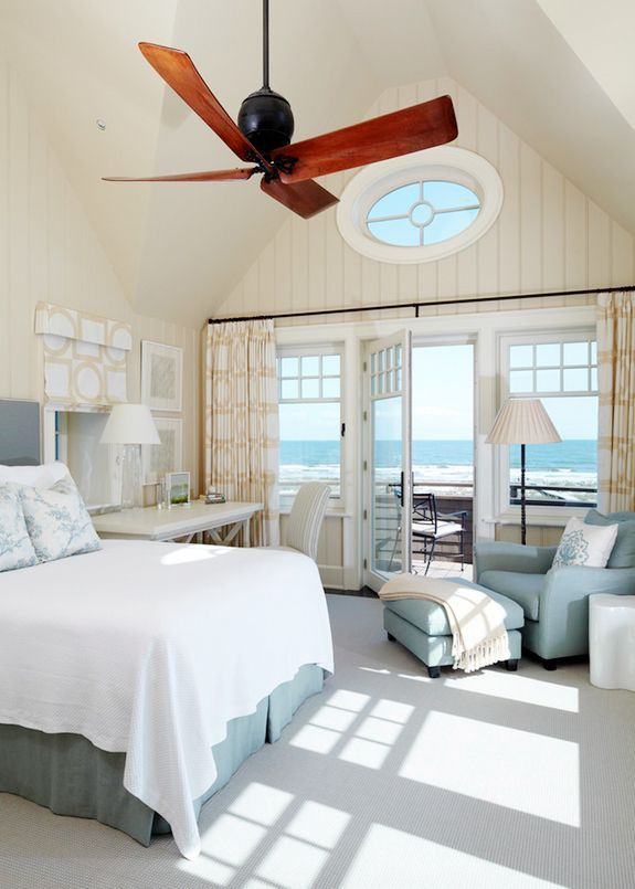 another white / cream beach house bedroom with lots of windows - I love the circular window
