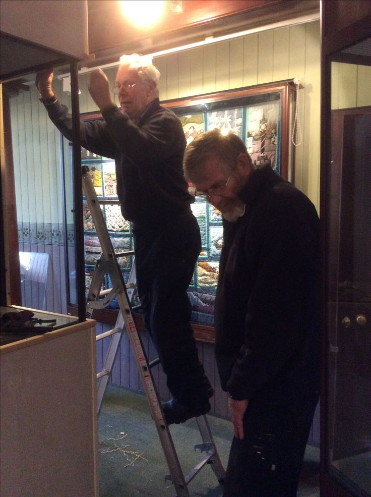 Ian and Don fixing a display case into the new wall