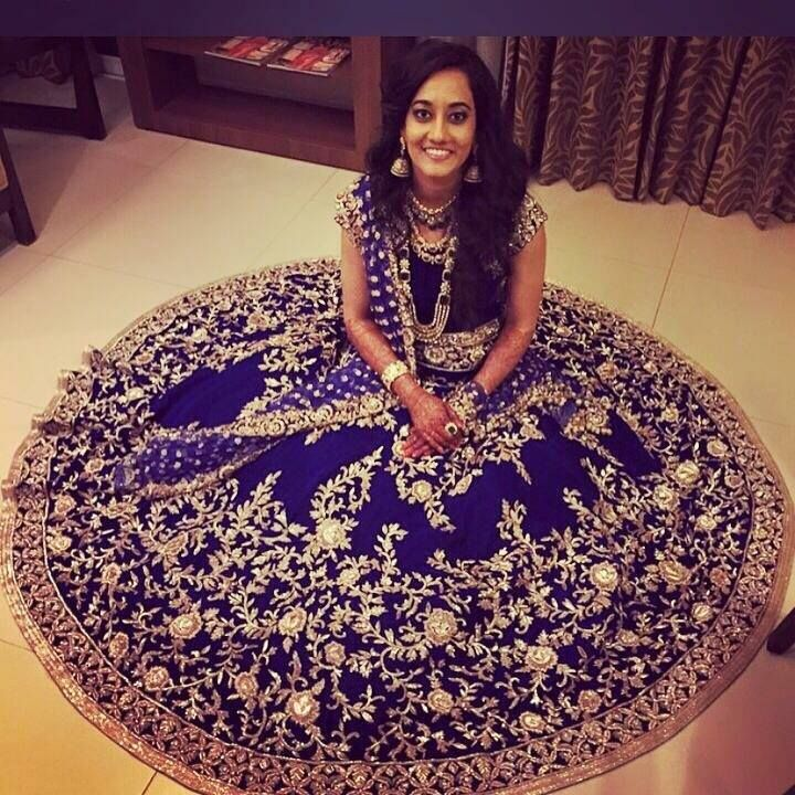 Embroidered vines and flowers on royal blue lehenga