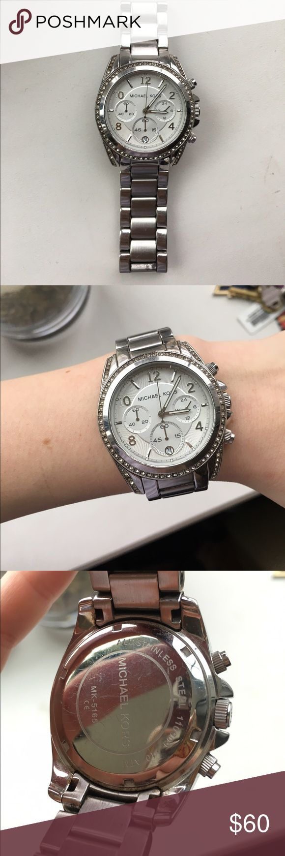 Michael Kors Silver Watch Michael Kors women's chronograph stainless steel watch in silver. Batteries are dead. A few stones are missing. Overall in pretty good condition. Michael Kors Jewelry
