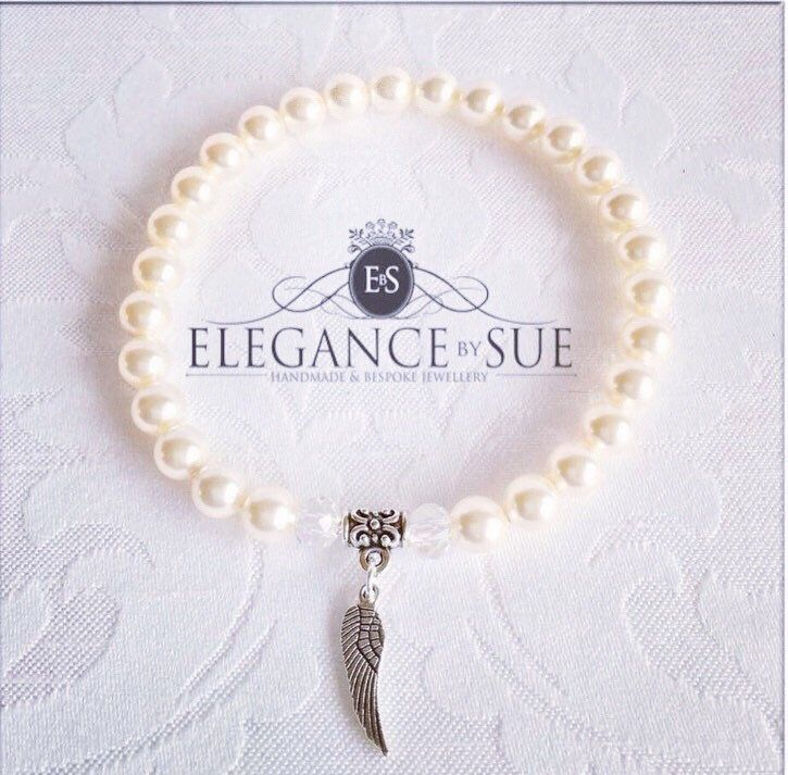 A personal favourite from my Etsy shop https://www.etsy.com/uk/listing/589420780/cream-pearl-and-angel-wing-charm-stretch
