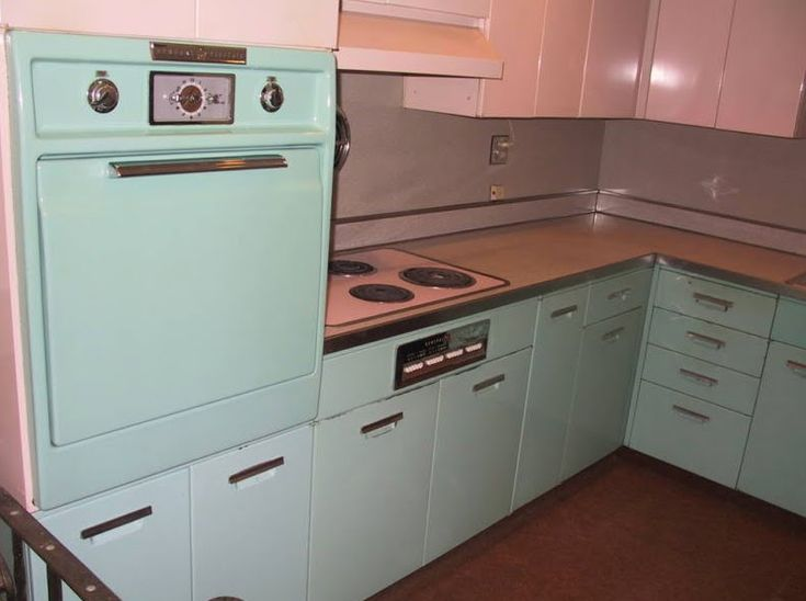 Now Weu0027re Getting A Little Closer To Home. A Late Atomic Kitchen, The Metal  Cabinets With Horizontal Pulls.