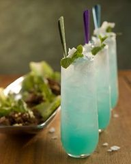 Blue Thai Mojito as Groom's signature drink! Something blue...   Ingredients 1/4 ounce blue Curaçao  1 1/2 ounces Bacardi Limon rum or Bacardi white rum 1 1/2 ounces Coco-Mint Syrup (recipe follows) 1 ounce fresh lime juice 2 ounces chilled soda water
