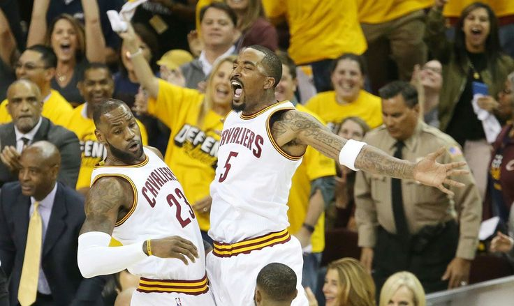 Cleveland Cavaliers forward LeBron James celebrates his dunk with teammate JR Smith against the Toronto Raptors in the first quarter during game 1 of the Eastern Conference semifinals, May 1, 2017, at Quicken Loans Arena.