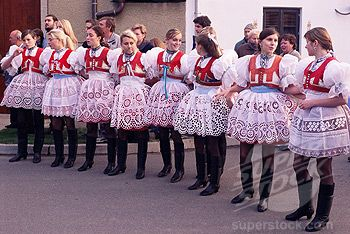 SuperStock - Girls in traditional dress lined up during ceremony, Dress Feast with Wreath and Duck Festival, village of Skoronice, Moravian Slovacko folk region, Skoronice, Brnensko, Czech Republic, Europe