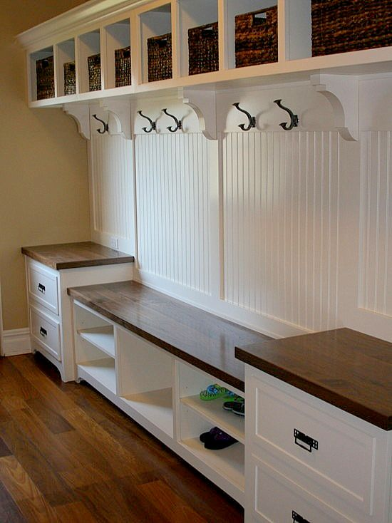 This would be a dream come true in the mud room/laundry room. Everyone would have a cubby and a hook and everything would have a place. Love this!
