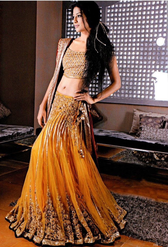 Yellow and gold, with a tinge of black. - From the Hina Khan Bridal Collection 2012