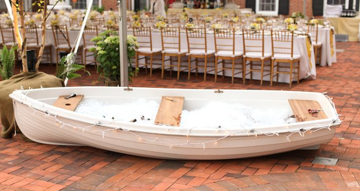 A canoe serves as the perfect beverage holder for this nautical inspired seaside wedding.   Photo by Aaron Snow Photography. www.wedsociety.com  #wedding #decoration