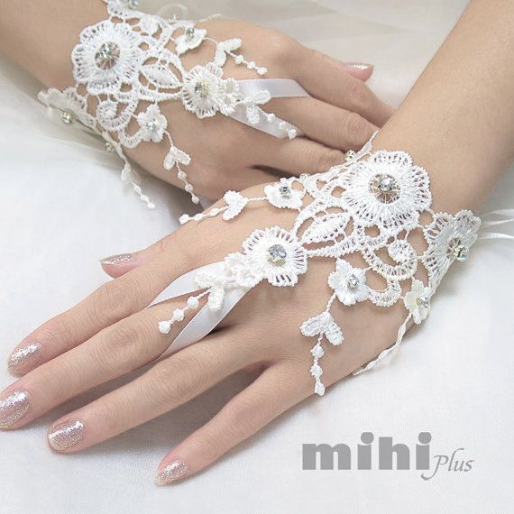 This listing is for a pair of Lace Gloves. Perfect for your wedding, prom, party or other formal occasion.  • Free size, with adjustable ribbon so it fit most hand.   ( if you worry about the size please contact us, we can custom it to fit you.) • 100% brand new. • 3-5 days to hand make lace glove. :)