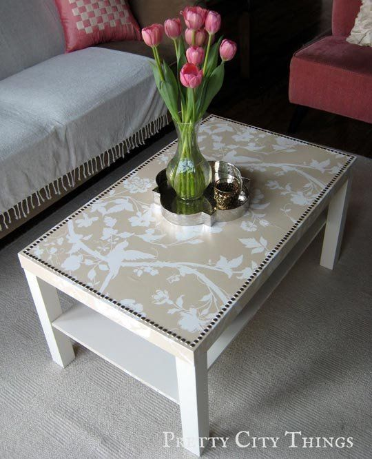 Wallpapered IKEA Lack Table — pray adhesive to adhere wallpaper to the tabletop. She then applied Mod Podge and spray shellac over the wallpaper to give it a protective coating.