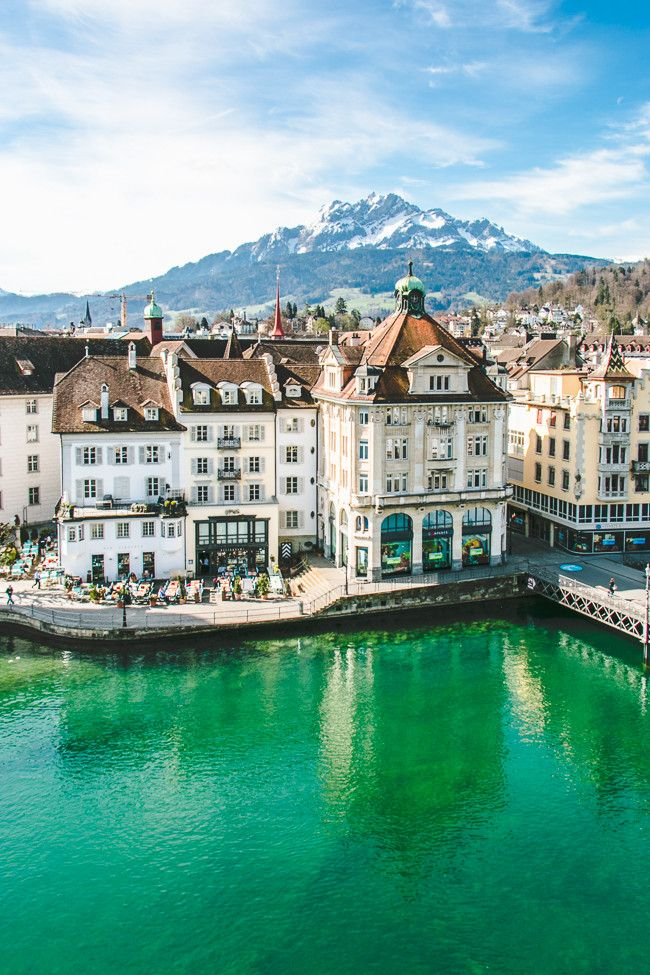 The view from Hotel des Balances with the Alps rising in the background // Lucerne, Switzerland • The Overseas Escape