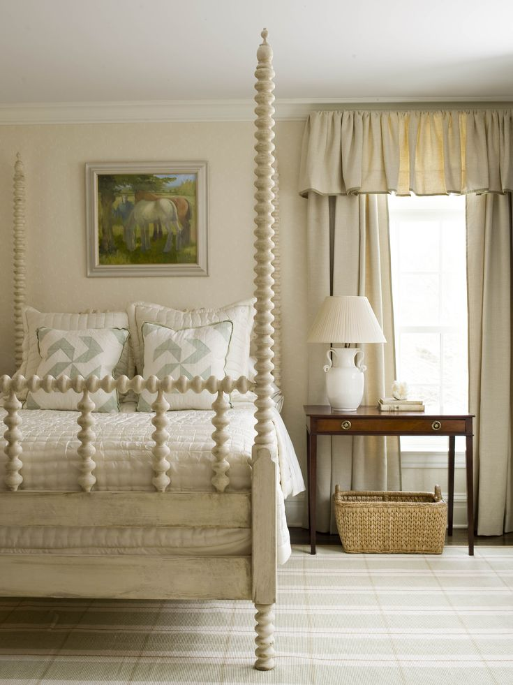 In this small bedroom with eight foot ceilings, the tall posters of the bed helps raise the perceived height of the ceiling, as do the curtains.