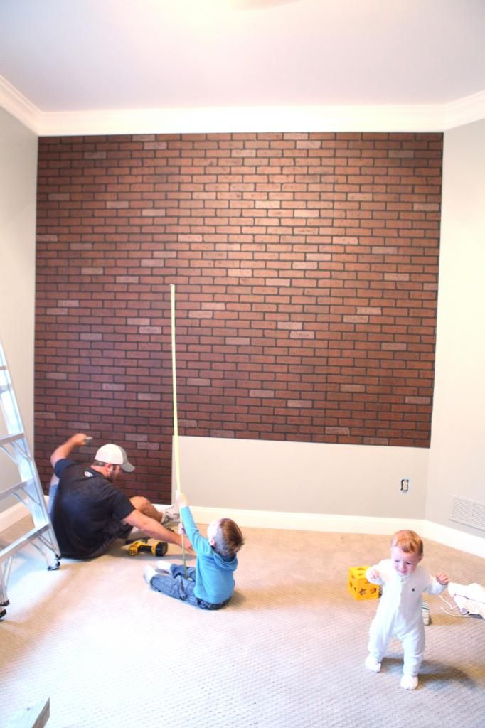 Faux brick accent wall. Buy panels at Lowe's, screw into studs, and paint over!