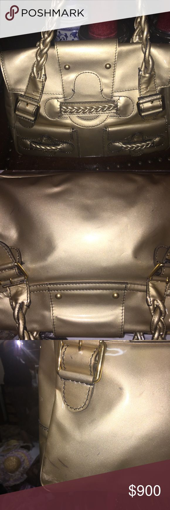 Valentino Gorgeous bag. Has some markings. It's gently used but with markings. Go to pics as shown. Final sale. Looks new inside no cracks on patent. Very soft leather. Gold as seen on Angelina Jolie Valentino Bags Satchels