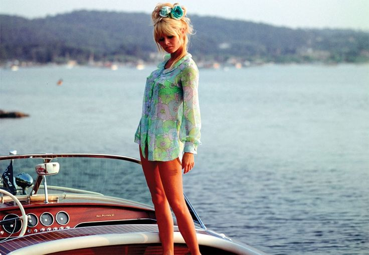 """Brigitte Bardot with her iconic Riva Super Florida (""""Nounours"""") in St Tropez in 1962"""