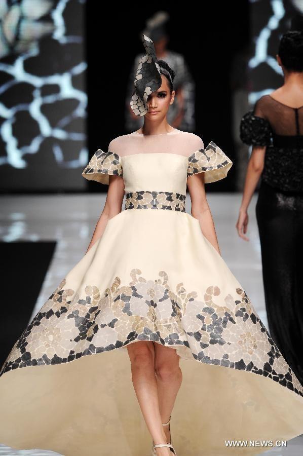 A model presents a creation designed by Sebastian Gunawan from Indonesia during the Jakarta Fashion Week 2013 at Plaza Senayan,