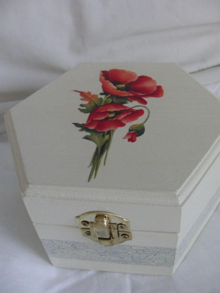 Wooden box with poppies.