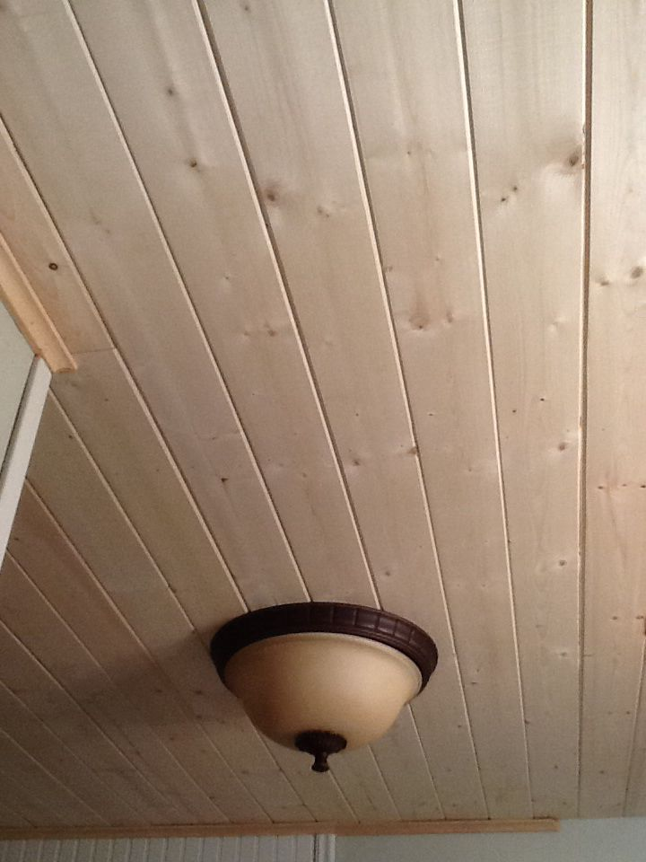 New plank ceiling covered old popcorn ceiling.  Easy to do in one afternoon, and cost less than $100.  We used Tongue and groove planks from Lowes.
