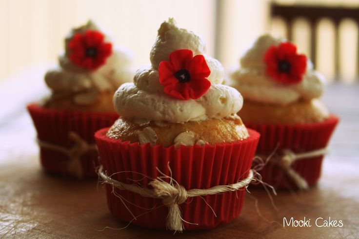 Lest We Forget.  Made for ANZAC Day here in Australia. Tastes like an ANZAC biscuit but as a cupcake. Fondant red poppy and vanilla cream.
