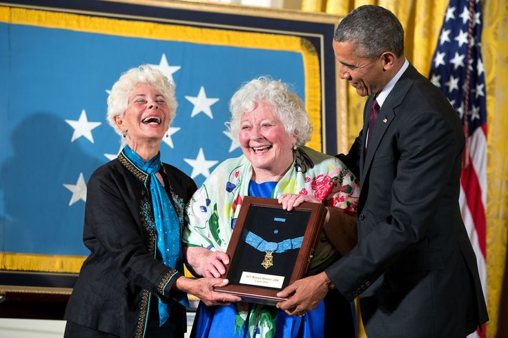 Ina Judith Bass (left) and Elise Shemin-Roth react after accepting the Medal of Honor from President Barack Obama on behalf of their father Army Sergeant William Shemin given posthumously for conspicuous gallantry during World War I, at a ceremony in the