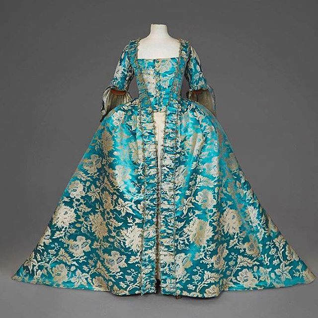 Aqua robe à la française from the mid-18th century!  How beautiful is this? The color is just superb! I would've loved to have seen how the original wearer wore this dress and seen it in its full glory. I hope this garment is being lovingly taken care of somewhere!  Daguerre Auctions