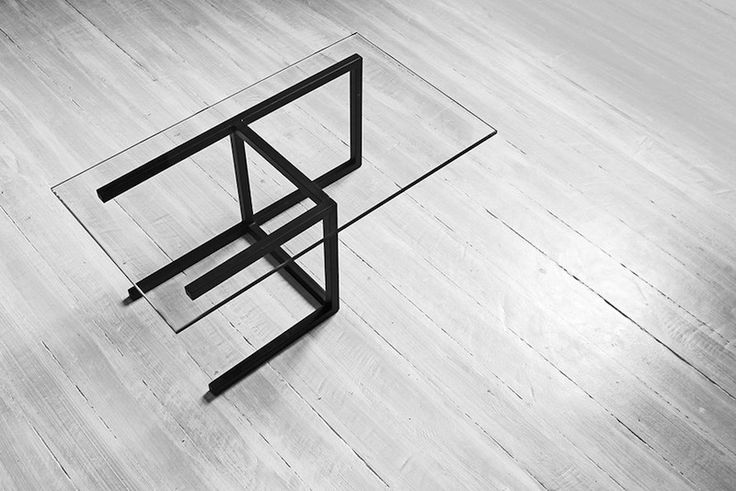 Arquétipo Center Table by Enrico Salis Design. The concept behind the work is to stimulate a different look on everyday objects. We are used to catalog everything we see in pre-defined archetypes, leaving little to the imagination. The goal here is to just break these archetypes, encouraging the audience to try a different view on things.