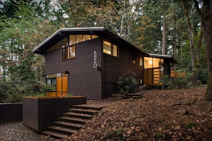 Gable roof modern exterior midcentury with window wall wood siding metal roof