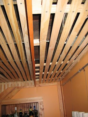 basement ceiling - close-up -- slats ; could attach cords to slats -- still have access; label the cords somewhere so easy to find